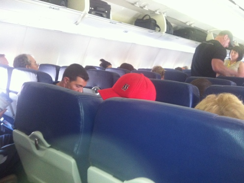 Sloppy fat Nazi-hat wearing loser in on flight to Austin.  Must make his momma proud.